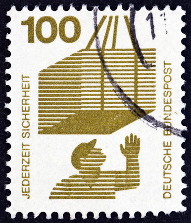 bundespost: GERMANY - CIRCA 1971: A stamp printed in Germany from the Accident Prevention issue shows crate on hoist, circa 1971.