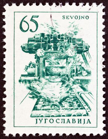 yugoslavia: YUGOSLAVIA - CIRCA 1961: A stamp printed in Yugoslavia from the Engineering & Architecture issue shows copper rolling mill in Sevojno, circa 1961.