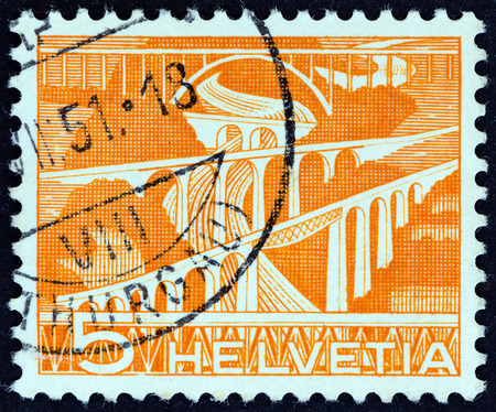 viaducts: SWITZERLAND - CIRCA 1949: A stamp printed in Switzerland shows Railway viaducts over River Sitter, near St. Gall, circa 1949.