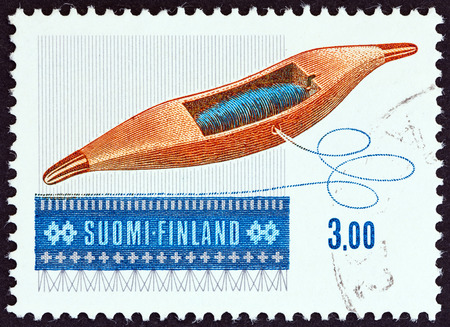 timbre: FINLAND - CIRCA 1979: A stamp printed in Finland from the Art of Weaving issue shows Weaving Shuttle Drive, circa 1979. Editorial