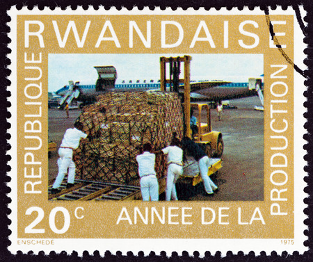 increased: RWANDA - CIRCA 1975: A stamp printed in Rwanda from the Year of Increased Production  issue shows loading Douglas DC-8F Jet Trader, circa 1975.