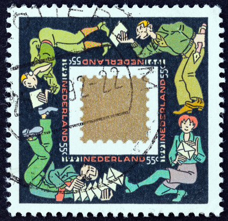 nederlan: NETHERLANDS - CIRCA 1991: A stamp printed in the Netherlands from the Christmas  issue shows Greetings Cards keep People in Touch, circa 1991.