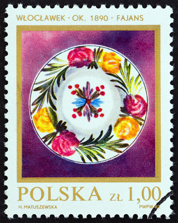 faience: POLAND - CIRCA 1982: A stamp printed in Poland from the Polish Ceramics  issue shows Faience Plate, circa 1982.