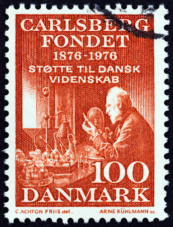physiologist: DENMARK - CIRCA 1976: A stamp printed in Denmark issued for the 100th Anniversary of the Carlsberg Foundation shows Professor Emil Hansen, circa 1976.