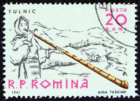 alphorn: ROMANIA - CIRCA 1961: A stamp printed in Romania from the Musicians  issue shows Alpenhorn player, circa 1961. Editorial
