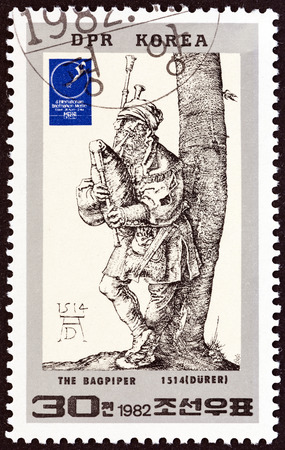engraver: NORTH KOREA - CIRCA 1982: A stamp printed in North Korea issued for the 4th Essen International Stamp Fair shows The Bagpiper (Durer), circa 1982. Editorial