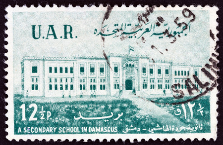 post secondary schools: UNITED ARAB REPUBLIC SYRIA - CIRCA 1959: A stamp printed in Syria shows Al-Haschimi Secondary School, Damascus, circa 1959. Editorial