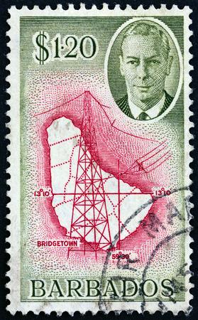 barbadian: BARBADOS - CIRCA 1950: A stamp printed in Barbados shows Map of Barbados, wireless mast and King George VI, circa 1950.