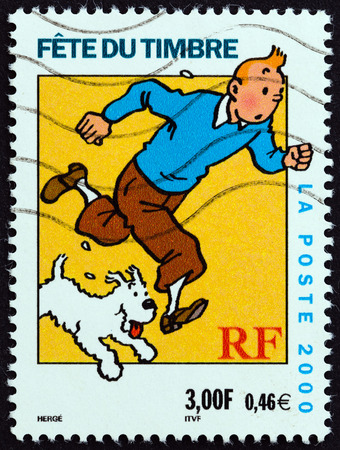 postes: FRANCE - CIRCA 2000: A stamp printed in France from the Stamp Day issue shows Tintin and Snowy (Milou), circa 2000. Editorial