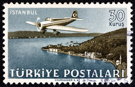 TURKEY - CIRCA 1949: A stamp printed in Turkey from the Turkish Aircraft over Landscapes issue shows Curtiss-Wright CW-22 over Istanbul, circa 1949.