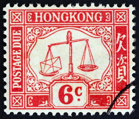 sello: HONG KONG - CIRCA 1938: A stamp printed in Hong Kong shows scales , circa 1938.