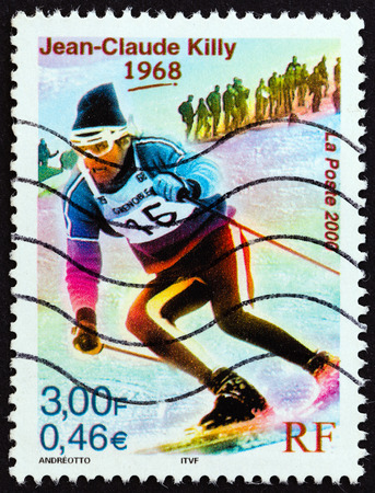 medalist: FRANCE - CIRCA 2000: A stamp printed in France from the Sport Events of the 20th Century  issue shows Jean-Claude Killy (Olympic Gold medalist downhill, giant and special slalom, 1968), circa 2000.