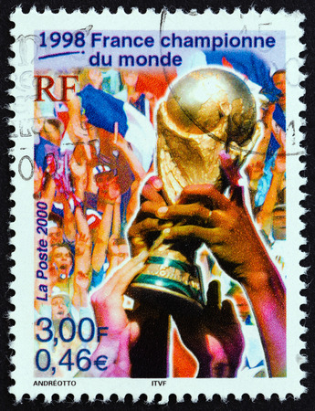 postes: FRANCE - CIRCA 2000: A stamp printed in France from the Sport Events of the 20th Century  issue shows Football World Cup Trophy (France, World Champions, 1998), circa 2000.