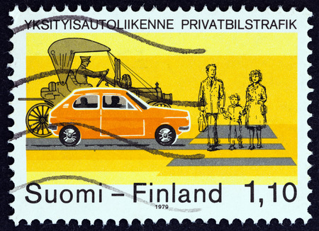 timbre: FINLAND  CIRCA 1979: A stamp printed in Finland shows Early and Modern Cars at Pedestrian Crossing circa 1979.