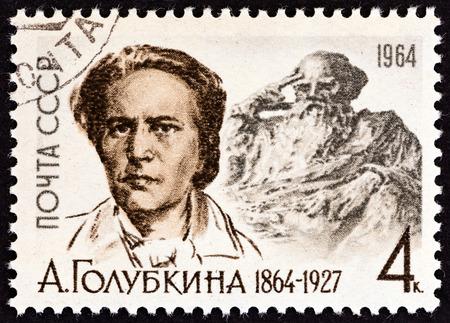 ulyanov: USSR  CIRCA 1964: A stamp printed in USSR issued for the birth centenary of Anna Semyonovna Golubkina shows sculptor Golubkina after N. Ulyanov and Tolstoy statue circa 1964.