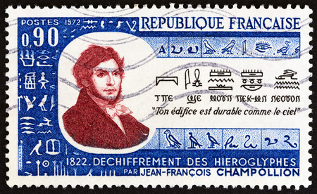 jeune: FRANCE  CIRCA 1972: A stamp printed in France issued for the 150th anniversary of the translation of Egyptian Hieroglyphics shows JeanFrancois Champollion and Hieroglyphics circa 1972.