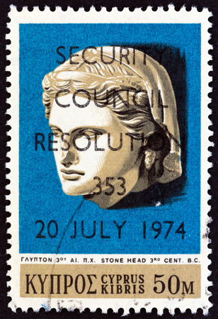 kibris: CYPRUS  CIRCA 1974: A stamp printed in Cyprus shows Hellenistic Stone Head 3rd century B.C. and U.N. Security Council Resolution 353 overprint circa 1974.