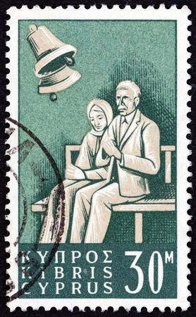 kypros: CYPRUS  CIRCA 1965: A stamp printed in Cyprus from the Social Insurance Law  issue shows Pensioners circa 1965. Editorial