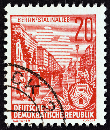 five year: GERMAN DEMOCRATIC REPUBLIC  CIRCA 1955: A stamp printed in Germany from the Five Year Plan issue shows Stalin Avenue Berlin circa 1955. Editorial