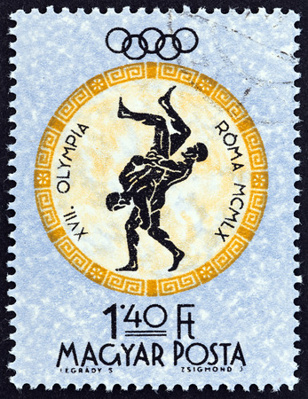 HUNGARY  CIRCA 1960: A stamp printed in Hungary from the Olympic Games. Rome Italy  issue shows Wrestling circa 1960.