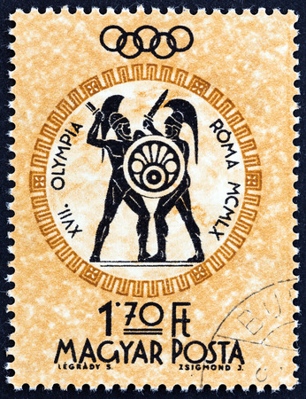 HUNGARY  CIRCA 1960: A stamp printed in Hungary from the Olympic Games. Rome Italy  issue shows Swordplay circa 1960.