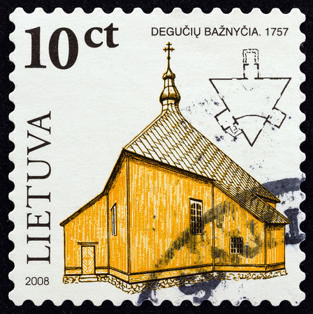 sacral: LITHUANIA  CIRCA 2008: A stamp printed in Lithuania from the Wooden Sacral Architecture in Lithuania  issue shows the church of Deguchiai 1757 circa 2008.