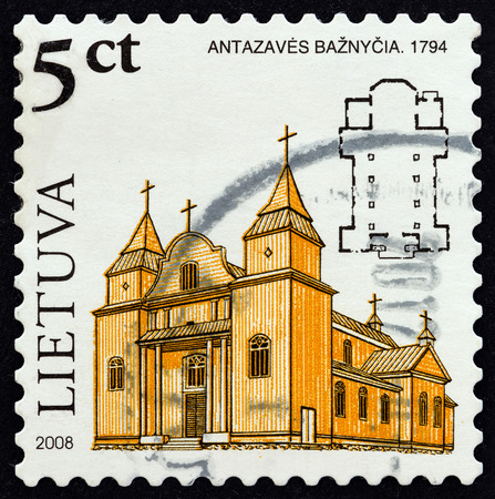 sacral: LITHUANIA  CIRCA 2008: A stamp printed in Lithuania from the Wooden Sacral Architecture in Lithuania  issue shows the church of Antazave 1794 circa 2008. Editorial