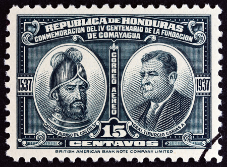spaniard: HONDURAS  CIRCA 1937: A stamp printed in Honduras issued for the 400th anniversary of Comayagua shows Alonso de Caceres and Tiburcio Carias Andino circa 1937.