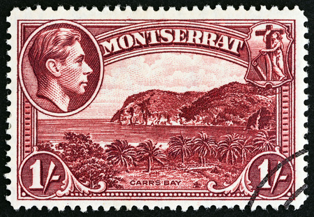 britannia: MONTSERRAT  CIRCA 1938: A stamp printed in Montserrat from the Landscapes King George VI  Coat of Arms  issue shows Carrs Bay circa 1938. Editorial