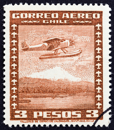 estampilla: CHILE  CIRCA 1934: A stamp printed in Chile shows Stinson Faucett F.19 seaplane in flight circa 1934.