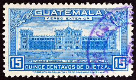 sello: GUATEMALA  CIRCA 1944: A stamp printed in Guatemala issued for the Inauguration of National Palace shows National Palace circa 1944.