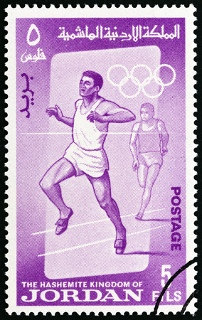 summer olympics: JORDAN  CIRCA 1964: A stamp printed in Jordan from the Olympic Games Tokyo  issue shows Running circa 1964. Editorial