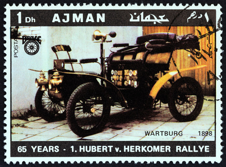 united arab emirate: AJMAN EMIRATE  CIRCA 1970: A stamp printed in United Arab Emirates from the 65th Anniversary of the Hubert V. Herkomer Rallye issue shows Wartburg of 1898 circa 1970.