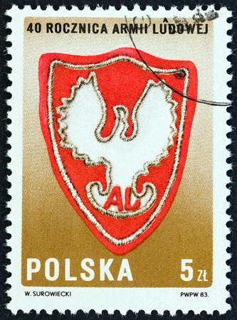 polska: POLAND  CIRCA 1983: A stamp printed in Poland issued for the 40th anniversary of People Army shows Badge of General Bem Brigade circa 1983.