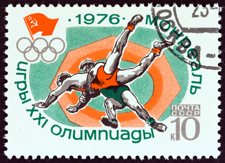 USSR  CIRCA 1976: A stamp printed in USSR from the Olympic Games Montreal  issue shows GraecoRoman wrestling circa 1976. Editorial