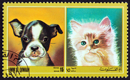 united arab emirate: UMM AL QIWAIN EMIRATE  CIRCA 1972: A stamp printed in United Arab Emirates from the Dogs and Cats  issue shows dog breed and cat breed circa 1972.