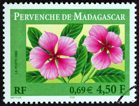 postes: FRANCE  CIRCA 2000: A stamp printed in France shows Madagascar periwinkle Catharanthus roseus circa 2000.
