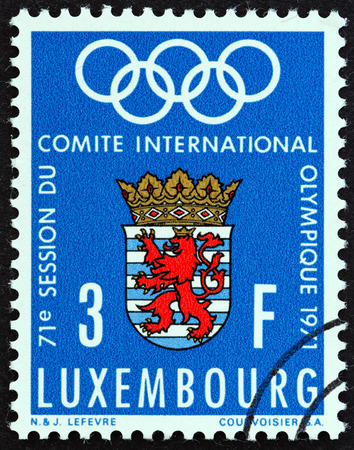 LUXEMBOURG  CIRCA 1971: A stamp printed in Luxembourg issued for the International Olympic Committee meeting Luxembourg shows Olympic Rings and Arms of Luxembourg circa 1971.
