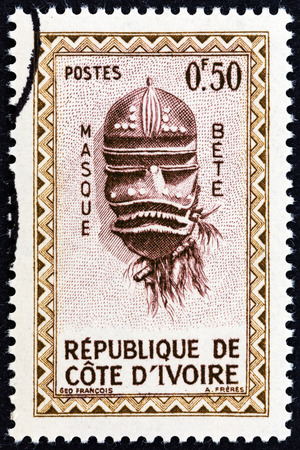 estampilla: IVORY COAST  CIRCA 1960: A stamp printed in Ivory Coast from the Native Masks  issue shows Bete Mask circa 1960.