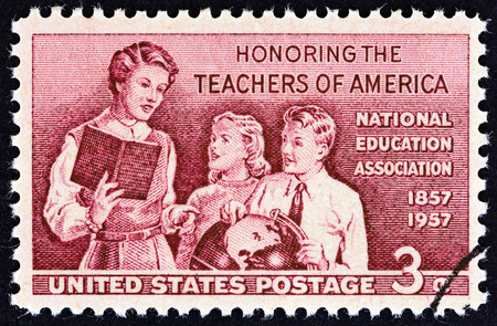 commemoration: USA  CIRCA 1957: A stamp printed in USA from the Teachers of America commemoration  issue shows teacher with pupils circa 1957.
