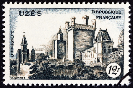 postes: FRANCE  CIRCA 1957: A stamp printed in France shows Uzes Chateau circa 1957.