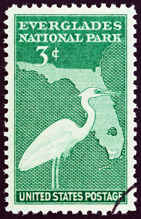 Everglades national park: USA  CIRCA 1947: A stamp printed in USA from the Everglades National Park  issue  shows Great Blue Heron and Map of Florida circa 1947. Editorial