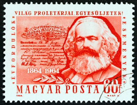 marx: HUNGARY  CIRCA 1964: A stamp printed in Hungary from the 100th Anniversary of the First International  issue shows Karl Marx circa 1964.
