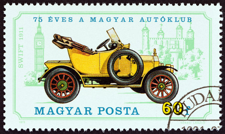 magyar posta: HUNGARY  CIRCA 1975: A stamp printed in Hungary from the 75th anniversary of Hungarian Automobile Club. Vintage cars  issue shows Swift 1911 and Big Ben circa 1975.