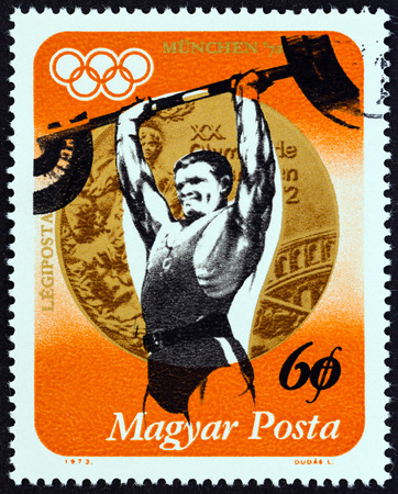 magyar posta: HUNGARY  CIRCA 1973: A stamp printed in Hungary from the Hungarian Medal Winners Olympic Games Munich  issue shows Imre Foldi Weightlifting Gold circa 1973.
