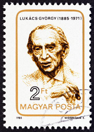magyar posta: HUNGARY  CIRCA 1985: A stamp printed in Hungary issued for the birth centenary of Gyorgy Lukacs shows philosopher Gyorgy Lukacs circa 1985.
