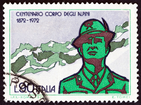 sello: ITALY  CIRCA 1972: A stamp printed in Italy from the 100th Anniversary of the Alpine Corps  issue shows Soldier and mountains circa 1972.