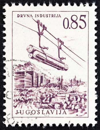 logging railway: YUGOSLAVIA  CIRCA 1966: A stamp printed in Yugoslavia from the Engineering  Architecture issue shows Timber industry cable railway circa 1966. Editorial