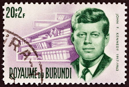 Kennedy: BURUNDI - CIRCA 1966: A stamp printed in Burundi from the Prince Rwagasore and President Kennedy Commemoration  issue shows President Kennedy and memorial library, circa 1966.