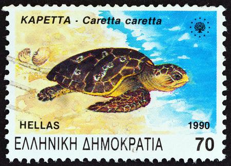 """schildkröte: GRIECHENLAND - CIRCA 1990: A in Griechenland gedruckt Stempel aus der """"Bedrohte Tiere"""" -Ausgabe zeigt Unechte Meeresschildkröte Caretta caretta, circa 1990. Editorial"""
